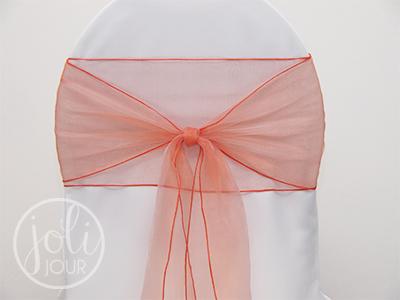 Location ruban orange corail organza pour housses de chaises